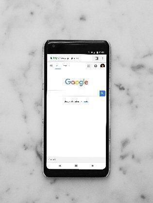 mobile phone showing google homepage
